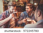 handsome friends are drinking... | Shutterstock . vector #572245783