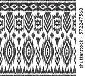 vector ikat seamless pattern.... | Shutterstock .eps vector #572247568