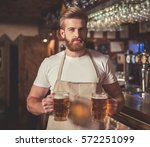 handsome bearded bartender in... | Shutterstock . vector #572251099