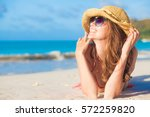 woman in bikini and straw hat... | Shutterstock . vector #572259820
