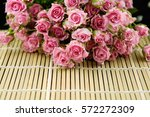 lying down bouquet pink rose on ... | Shutterstock . vector #572272309