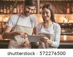 beautiful young baristas are... | Shutterstock . vector #572276500