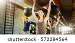 exercising at gym with pilates... | Shutterstock . vector #572284564