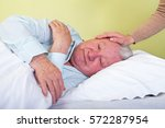 Small photo of Picture of an agonized elderly man in bed
