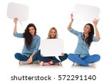 three seated young women smile... | Shutterstock . vector #572291140