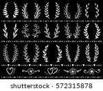 vintage hand drawn wreaths set...   Shutterstock .eps vector #572315878