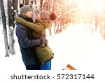 couple in love outdoor winter | Shutterstock . vector #572317144