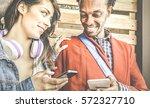 multiracial couple flirting... | Shutterstock . vector #572327710