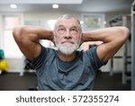 fit senior man in gym working... | Shutterstock . vector #572355274