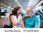 senior couple in gym sitting in ... | Shutterstock . vector #572355364