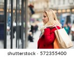 woman window shopping in centre ... | Shutterstock . vector #572355400