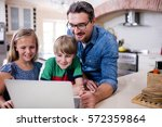 father and kids using laptop in ... | Shutterstock . vector #572359864