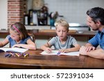 father helping kids with their... | Shutterstock . vector #572391034