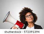 business black woman holding a... | Shutterstock . vector #572391394