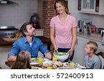 woman serving food to her...   Shutterstock . vector #572400913