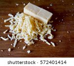 shredded cheese on wood table | Shutterstock . vector #572401414