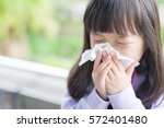 little girl get cold and blow... | Shutterstock . vector #572401480