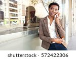 beautiful african american... | Shutterstock . vector #572422306