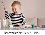 portrait of smiling cute... | Shutterstock . vector #572424460