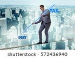 businessman balancing between...   Shutterstock . vector #572436940