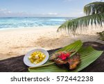 Stock photo plate of creole food with fish and mango salad on seychelles islands anse source d argent beach 572442238