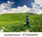 tourist girl walking on a... | Shutterstock . vector #572443696