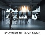 side view of a businessman with ... | Shutterstock . vector #572452234