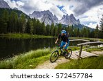 mountain biking in the... | Shutterstock . vector #572457784