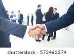 business people shaking hands ... | Shutterstock . vector #572462374