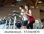 people working out in a gym | Shutterstock . vector #572464870