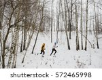 healthy young couple jogging... | Shutterstock . vector #572465998