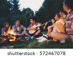 happy friends playing music and ... | Shutterstock . vector #572467078