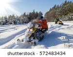 the sportsman on a snowmobile... | Shutterstock . vector #572483434