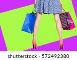shopping woman legs holding... | Shutterstock . vector #572492380