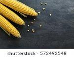 Sweet Corns On A Grey Wooden...