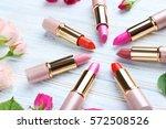 colorful lipsticks on white...   Shutterstock . vector #572508526