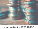 rows of coins for finance and... | Shutterstock . vector #572510458