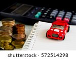 car coins and calculator on... | Shutterstock . vector #572514298