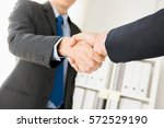 businessmen making handshake in ... | Shutterstock . vector #572529190