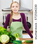 woman young housewife in... | Shutterstock . vector #572534230