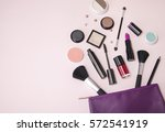 a purple leather make up bag... | Shutterstock . vector #572541919