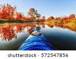 Blue Kayak Sailing Down A River ...