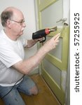 Stock photo tool man using paint remover 57255925