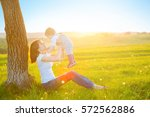 beautiful young woman with boy... | Shutterstock . vector #572562886