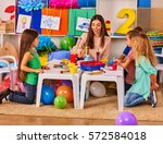 children painting and drawing... | Shutterstock . vector #572584018
