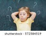 top view of a little blond kid... | Shutterstock . vector #572584519