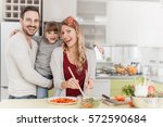 happy family preparing meal... | Shutterstock . vector #572590684
