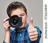 Boy With Photo Camera Taking...