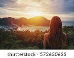 A girl admiring amazing sunset on Phi Phi island. View from the back.
