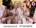 pretty bridesmaids surround... | Shutterstock . vector #572620828